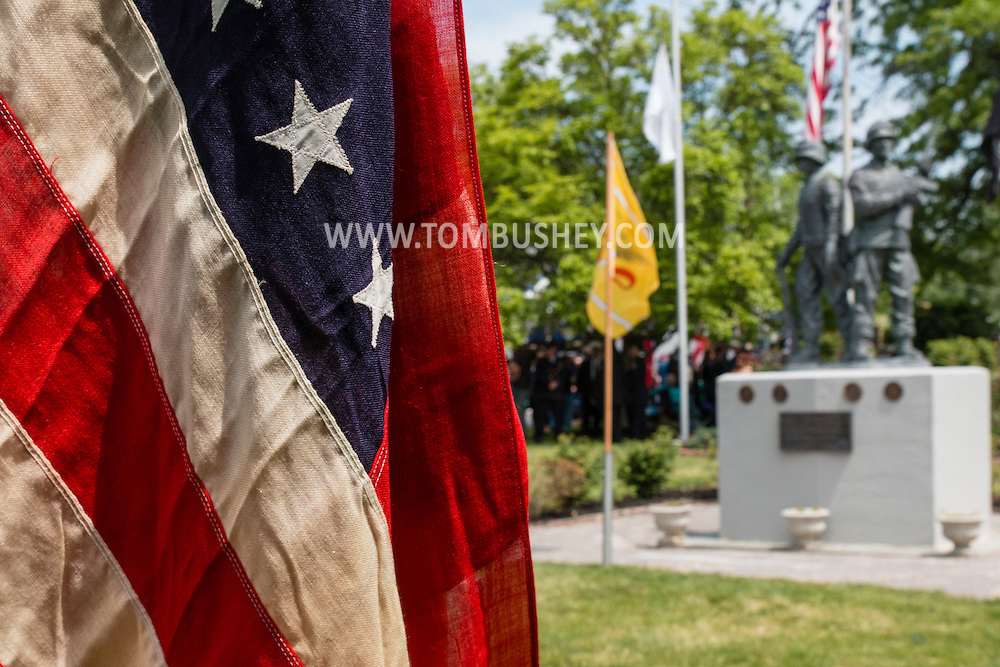 Town of Wallkill, New York - An American flag flies during Middletown-Town of Wallkill Memorial Day ceremonies at Town of Wallkill Veterans Park on May 25, 2015.