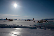 Two Twin Otter from Transport Squadron 440 after landing at a Rangers camp on Devon Island. Rangers were sent on snowmobile patrol during Nunalivut 2012, resupply of fuel and food came by air.