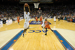 Georgia Tech forward/center Alade Aminu (44) goes up for a dunk against UVA.  The Virginia Cavaliers faced the Georgia Tech Yellow Jackets in the first round of the 2008 ACC Men's Basketball Tournament at the Charlotte Bobcats Arena in Charlotte, NC on March 13, 2008.