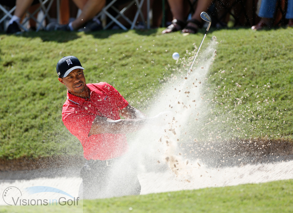 Tiger Woods   hits his shot out of the bunker trap<br /> on the final day at the 2013 TOUR Championship, by Coca Cola, East Lakes GC, Atlanta, Georgia, USA. FedEx Playoffs<br /> Picture Credit:  Mark Newcombe / visionsingolf.com