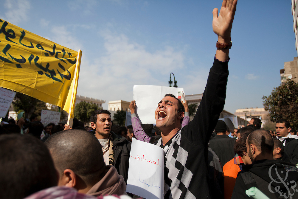 Protesters demonstrate outside the parliament complex during the historic first session of Egypt's newly elected Parliament Jan 23, 2012 in Cairo, Egypt.