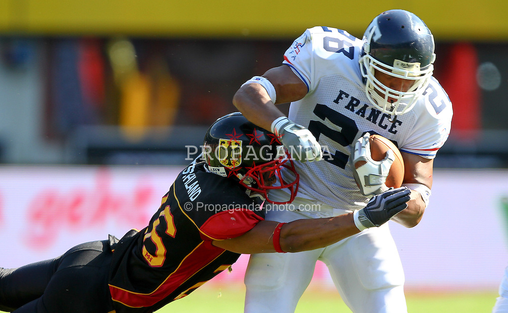 16.07.2011, Ernst Happel Stadion, Wien, AUT, American Football WM 2011, Germany (GER) vs France (FRA), im Bild tackle from Matthias Eck (Germany, #26, DB) against Laurent Marceline   (France, #28, RB )  // during the American Football World Championship 2011 game, Germany vs France, at Ernst Happel Stadion, Wien, 2011-07-16, EXPA Pictures © 2011, PhotoCredit: EXPA/ T. Haumer