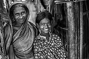 Farjana, age 9, and her mother at their home in a Bangladesh slum.
