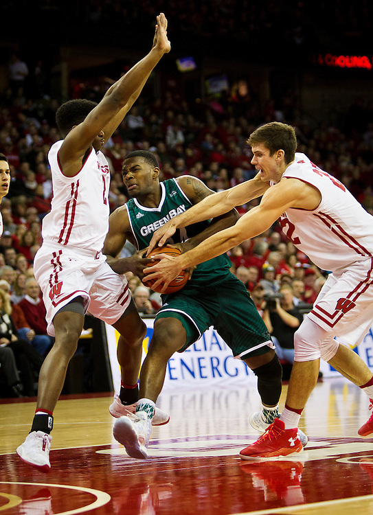 UW-Green Bay forward Charles Cooper  (34) drives the lane during the first half of the UW-Green Bay Men's Basketball game versus University of Wisconsin at the Kohl Center, Wednesday, December 14, 2016.