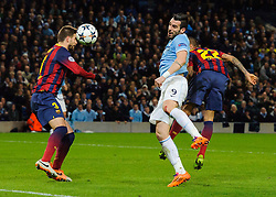 Man City Forward Alvaro Negredo (ESP) heads a shot past Barcelona Defender Gerard Pique (ESP) - Photo mandatory by-line: Rogan Thomson/JMP - Tel: 07966 386802 - 18/02/2014 - SPORT - FOOTBALL - Etihad Stadium, Manchester - Manchester City v Barcelona - UEFA Champions League, Round of 16, First leg.