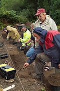 SAVEOCK WATER, CORNWALL, ENGLAND - AUGUST 03: A view from the side of archaeologist Jacqui Wood, her team and students on August 3, 2008 in Saveock Water, Cornwall. They are excavating a Mesolithic platform. (Photo by Manuel Cohen)