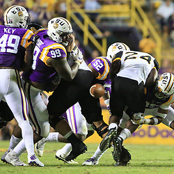 Oct 15, 2016; Baton Rouge, LA, USA;  LSU Tigers safety Jamal Adams (33) tackles and forces a fumble by Southern Miss Golden Eagles running back George Payne (24) during the third quarter of a game at Tiger Stadium. Mandatory Credit: Derick E. Hingle-USA TODAY Sports