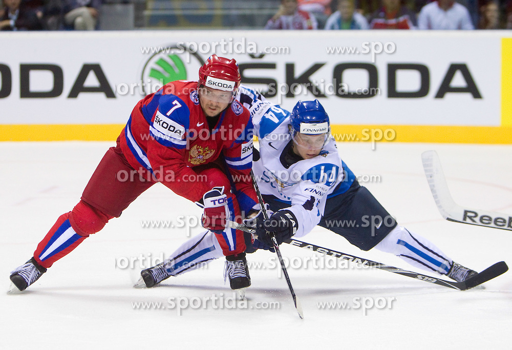 Dmitri Kalinin of Russia vs Mikael Granlund of Finland during ice-hockey match between Russia and Finland of Group E in Qualifying Round of IIHF 2011 World Championship Slovakia, on May 9, 2011 in Orange Arena, Bratislava, Slovakia. Finland defeated Russia after overtime and shootout 3-2. (Photo By Vid Ponikvar / Sportida.com)