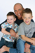 Studio portrait of dad with children