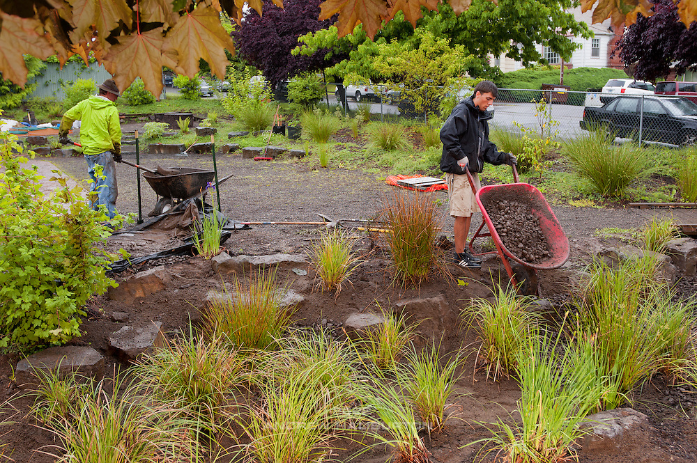 Josh Lighthipe and Adrian Lucas volunteer at the rain garden work meet, Café au Play at Tabor Commons, a project of the Southeast Uplift Neighborhood Coalition (SEUL) and volunteers from Portland's Mt Tabor neighborhood.