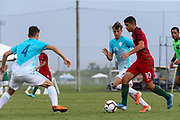 Portugal midfielder Marco Cruz (10) carries the ball upfield while Slovenia midfielder Gal Puconja (8) looks to tackle during a CONCACAF boys under-15 championship soccer game, Sunday, August 11, 2019, in Bradenton, Fla. Portugal defeated Slovenia in the final in 2-0. (Kim Hukari/Image of Sport)