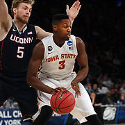 Melvin Ejim, (right), Iowa, is defended by Niels Giffey, UConn, during the Iowa State Cyclones Vs Connecticut Huskies basketball game during the 2014 NCAA Division 1 Men's Basketball Championship, East Regional at Madison Square Garden, New York, USA. 28th March 2014. Photo Tim Clayton