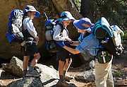 Hike with children in Sawtooth Wilderness Area, Idaho, USA. Sawtooth Wilderness, managed by the US Forest Service within Sawtooth National Recreation Area, has some of the best air quality in the lower 48 states (says the US EPA).