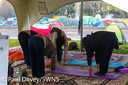 "A group practices Yoga in the ""wellbeing tent"" as hundreds of environmental protesters from Extinction Rebellion occupy Marble Arch, camping in the square and even on the streets, blocking access to traffic on Park Lane and Oxford Street in London's usually traffic-heavy west end. . London, April 16 2019."