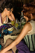 Minette and Francine just finished their can can performance for the night at the Moulin Rouge, Paris, 1900's. As they do every night. Tired,looking for mutual support, they share a their loneliness and a glass of absinthe to quench their internal sadness. Attraction gets more intimate by the moment. Models Erin and Kaelin