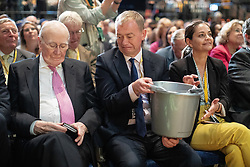 © Licensed to London News Pictures . 17/09/2019. Bournemouth, UK. The donation bucket is passed from TIM FARRON (c) to MENZIES CAMPBELL (l) ahead of the Leader's Speech on the final day of the Liberal Democrat Party Conference at the Bournemouth International Centre . Photo credit: Joel Goodman/LNP