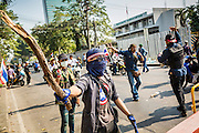 "01 FEBRUARY 2014 - BANGKOK, THAILAND: Anti-government protestors armed with clubs taunt voters who tried to get past them to vote. The anti-government protestors also had guns and threatened to shoot people who wanted to vote. Thais went to the polls in a ""snap election"" Sunday called in December after Prime Minister Yingluck Shinawatra dissolved the parliament in the face of large anti-government protests in Bangkok. The anti-government opposition, led by the People's Democratic Reform Committee (PDRC), called for a boycott of the election and threatened to disrupt voting. Many polling places in Bangkok were closed by protestors who blocked access to the polls or distribution of ballots. The result of the election are likely to be contested in the Thai Constitutional Court and may be invalidated because there won't be quorum in the Thai parliament.    PHOTO BY JACK KURTZ"