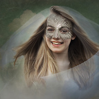 young teenager wearing a mask, in the wind with hair and veil blowing