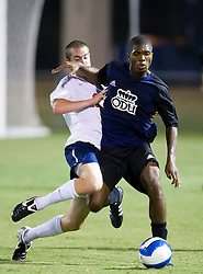 Old Dominion Monarchs midfielder Nane Joseph (7) is fouled by Virginia Cavaliers defender Hunter Jumper (28).  The Virginia Cavaliers defeated the Old Dominion Monarchs 3-0 in a pre-season NCAA Men's Soccer exhibition game held at Klockner Stadium on the Grounds of the University of Virginia in Charlottesville, VA on August 23, 2008.