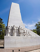 """The Alamo Cenotaph (empty tomb) entitled 'The Spirit of Sacrifice' is a tower of 60 feet built to pay tribute to these heroes who died during The Battle of Alamo. Standing adjacent to Long Barrack of The Alamo Complex, it was designed by Italian-born sculptor Pompeo Coppini and completed in 1939. Among the figures carved on the wall are William B. Travis, Jim Bowie, David Crockett and James B. Bonham. Now heroes of """"The Lone Star State,"""" their sacrifice led to the founding of Texas. """"Never surrender nor retreat."""" The Alamo Mission in San Antonio (or """"The Alamo"""") was originally known as Mission San Antonio de Valero, a former Roman Catholic mission and fortress compound, and the site of the Battle of the Alamo in 1836. It is now a museum in the Alamo Plaza District of Downtown San Antonio, Texas, USA. This panorama was stitched from 3 overlapping photos."""