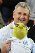 English fan with Shrek doll during the Friendly match between England and Spain at Wembley Stadium, London, England on 15 November 2016. Photo by Matthew Redman.