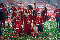 LIVERPOOL, ENGLAND - Wednesday, July 22, 2020: Liverpool's Brazilian trio Fabio Henrique Tavares 'Fabinho', Roberto Firmino and goalkeeper Alisson Becker celebrate with the Premier League trophy and their winners' medal as the Reds are crowned Champions after the FA Premier League match between Liverpool FC and Chelsea FC at Anfield. The game was played behind closed doors due to the UK government's social distancing laws during the Coronavirus COVID-19 Pandemic. Liverpool won 5-3. (Pic by David Rawcliffe/Propaganda)