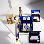 arrangement of Christian Dior cosmetics on white shelf