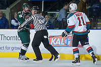 KELOWNA, CANADA - DECEMBER 30: Stathis Soumelidis #18 of the Everett Silvertips is pushed away from Carter Rigby #11 of the Kelowna Rockets by linesman Ward Pateman at the Kelowna Rockets on December 30, 2012 at Prospera Place in Kelowna, British Columbia, Canada (Photo by Marissa Baecker/Shoot the Breeze) *** Local Caption ***