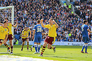Burnley defender Michael Keane (5) scores and celebrates with Sam Vokes his equalising goal 2-2 during the Sky Bet Championship match between Brighton and Hove Albion and Burnley at the American Express Community Stadium, Brighton and Hove, England on 2 April 2016. Photo by Phil Duncan.