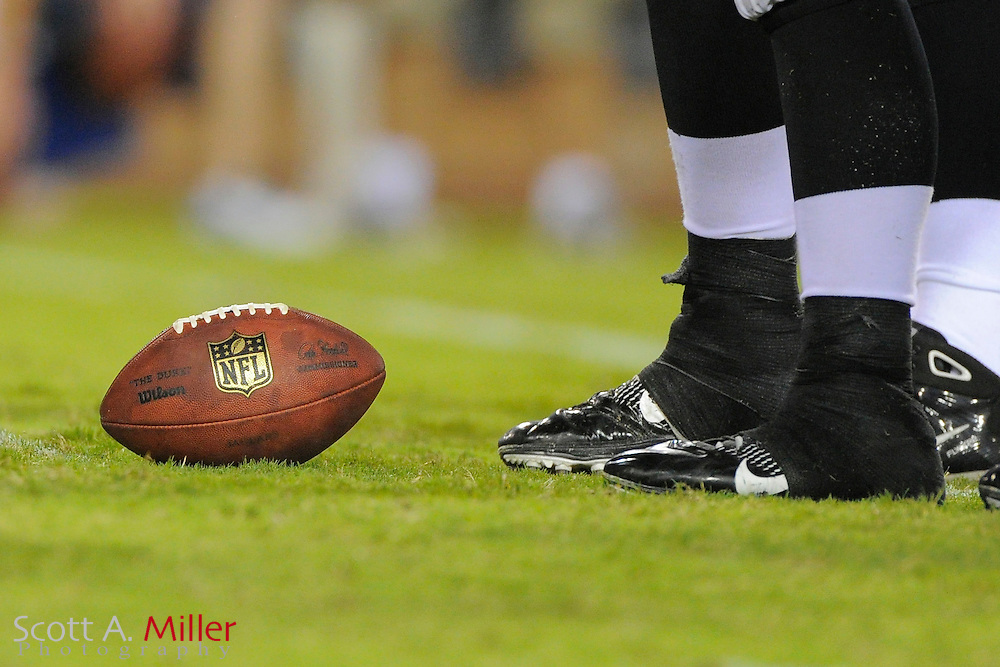 An NFL football sits on the field during the Jacksonville Jaguars-New York Giants NFL preseason game at EverBank Field on August 10, 2012 in Jacksonville, Florida. ©2012 Scott A. Miller..