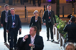 © Licensed to London News Pictures  . 03/10/2017 . Manchester , UK . Prime Minister THERESA MAY crosses from the Midland Hotel to the conference centre at the start of day three of the Conservative Party Conference at the Manchester Central Convention Centre . Photo credit : Joel Goodman/LNP