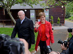 SNP leader Nicola Sturgeon with husband Peter Murrell at her local polling station in Glasgow after casting her vote in the European elections.<br /> <br /> © Dave Johnston / EEm
