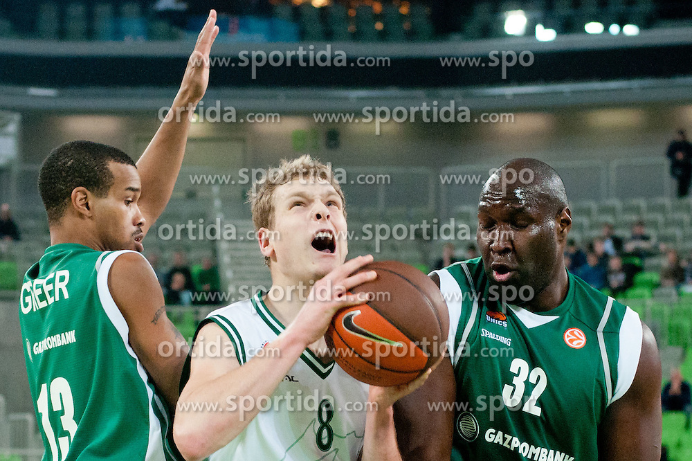 Jaka Blazic of Union Olimpija between Lynn Greer of Unics Kazan and Nathan Jawai of Unics Kazan during basketball match between KK Union Olimpija and Unics Kazan (RUS) of 10th Round in Group D of Regular season of Euroleague 2011/2012 on December 21, 2011, in Arena Stozice, Ljubljana, Slovenia. (Photo by Matic Klansek Velej / Sportida)