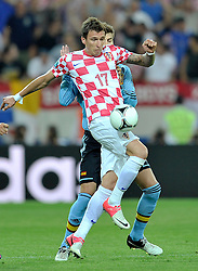 Croatia's Mario Mandzukic (nr17) fights for the ball during the UEFA EURO 2012 Group C football match between Spain and Croatia at Gdansk Arena in Gdansk on June 18, 2012...Poland, Gdansk, June 18, 2012..Picture also available in RAW (NEF) or TIFF format on special request...For editorial use only. Any commercial or promotional use requires permission...Photo by © Adam Nurkiewicz / Mediasport