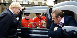 © Licensed to London News Pictures. 02/05/2012. London, UK London Mayor, Boris Johnson (L) is joined by comedian Al Murray (r )to wave off an army of WWII veterans who are embarking on an iconic trip to the Netherlands, via a convoy of black cabs. The London Taxi Benevolent Association for the War Disabled has organised a trip for 160 WWII veterans to travel to Holland in 80 London Black Cabs. The veterans, mostly aged between 85 and 94, will start their journey from London today 2nd May 2012 and will be visiting sites of importance from WWII and taking part in Dutch Liberation Day celebrations as guests of honour of the Dutch Royal Family.. Photo credit : Stephen Simpson/LNP