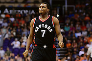 Dec 29, 2016; Phoenix, AZ, USA;  Toronto Raptors guard Kyle Lowry (7) reacts while walking up the court during the first half of the NBA game against the Phoenix Suns at Talking Stick Resort Arena. Mandatory Credit: Jennifer Stewart-USA TODAY Sports