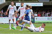 Jake Reeves of AFC Wimbledon is surrounded by Notts County defenders, during the Sky Bet League 2 match between AFC Wimbledon and Notts County at the Cherry Red Records Stadium, Kingston, England on 19 September 2015. Photo by Stuart Butcher.