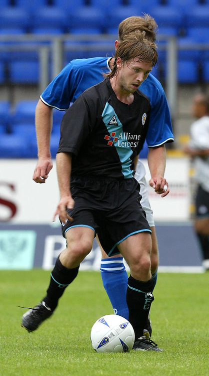 St Johnstone v Leicester City..24.07.04 (Friendly) <br />David Connolly holds off Ian Maxwell<br /><br />Picture by Graeme Hart.<br />Copyright Perthshire Picture Agency<br />Tel: 01738 623350  Mobile: 07990 594431