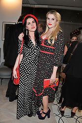 Left to right, sisters COCO FENNELL and EMERALD FENNELL at a party to celebrate the publication of Fame Game by Louise Fennell held at Grace, West Halkin Street, London on 12th March 2013.