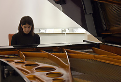 A staff member plays an Imperial Bosendorfer concert grand piano, played by Queen, Coldplay, Robbie Williams and Talk Talk on display ahead of the the Entertainment Memorabilia Sale at Bonhams in Knightsbridge, London later this week.
