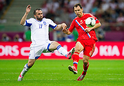 Fanis Gekas  of Greece vs Sergei Ignashevich of Russia during the UEFA EURO 2012 group A match between  Greece and Russia at The National Stadium on June 16, 2012 in Warsaw, Poland.  Greece defeated Russia 1-0 and qualified to Quarterfinals. (Photo by Vid Ponikvar / Sportida.com)