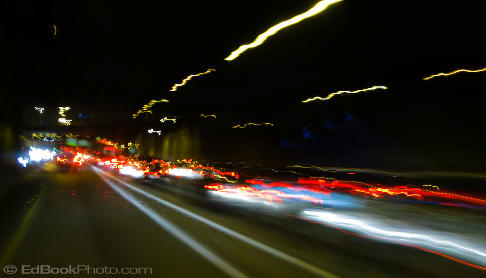 heavy traffic at night on I-5 in downtown Seattle with motion blurred taillights, Washington state