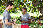 ICS volunteers Joe Radcliffe and Bertha Mhepela assist students during a mid class role play session at Mingoyo school as part of the VSO / ICS Elimu Fursa project (Opportunities in Education) Lindi, Lindi region. Tanzania.