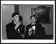 William Nott and Edward Hoare  here are having an early attempt at smoking  cigars. at the Grattan-Bellew/Sebag-Montefiore/Courtauld dance. Boodles. London. 1981. Film 81173f1 This was  at the first  debutante dance I  photographed..