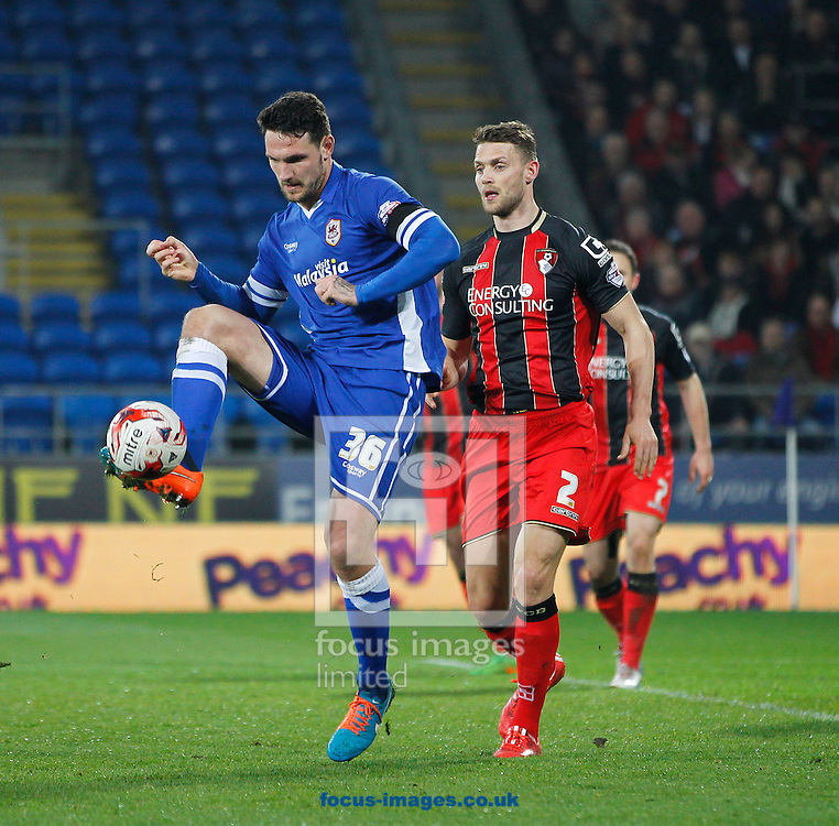 Sean Morrison of Cardiff City and Simon Francis of Bournemouth during the Sky Bet Championship match at the Cardiff City Stadium, Cardiff<br /> Picture by Mike Griffiths/Focus Images Ltd +44 7766 223933<br /> 17/03/2015