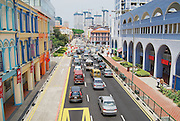 SINGAPORE, SINGAPORE - AUGUST 05, 2008: View to the colorful street with cars passing by in Singapore, Singapore.