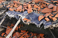 Melted plastic roofing material in the remains of a building destroyed by a pyroclastic flow, Gungung Merapi, Kinahrejo, Java, Indonesia.