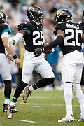 Jacksonville Jaguars defensive back D.J. Hayden (25) celebrates with Jacksonville Jaguars cornerback Jalen Ramsey (20) after intercepting a first quarter pass and running it back 10 yards to the Jaguars 28 yard line during the NFL week 13 regular season football game against the Indianapolis Colts on Sunday, Dec. 2, 2018 in Jacksonville, Fla. The Jaguars won the game in a 6-0 shutout. (©Paul Anthony Spinelli)