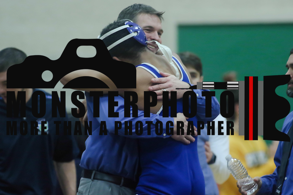 Middletown Isiah Mitchell celebrates with a coach after defeating Hodgson Joey Fonseca in a 170 pound bout during the Blue Hen Conference Wrestling Tournament Finals Saturday, Feb. 20, 2016 at William Penn High School in New Castle.