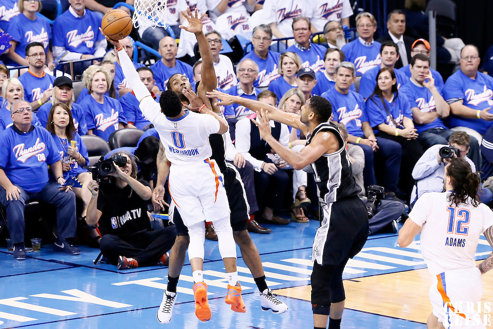06 May 2016: Oklahoma City Thunder guard Russell Westbrook (0) goes for the layup against San Antonio Spurs forward Kawhi Leonard (2) during the San Antonio Spurs 100-96 victory over the Oklahoma City Thunder, during Game Three of the Western Conference Semifinals of the NBA Playoffs at the Chesapeake Energy Arena, Oklahoma City, Oklahoma, USA.